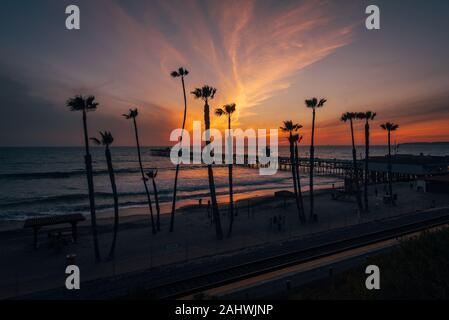 The San Clemente Pier at sunset, in Orange County, California - Stock Photo