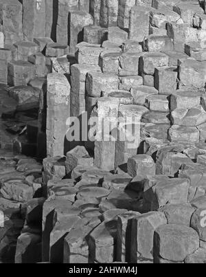 Massive basalt columns and stepping stones of the Giant's Causeway in black and white, County Antrim, Northern Ireland, UK.