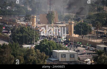 Baghdad, Iraq. 01st Jan, 2020. Iraqi Security Forces guard the outside of the U.S. Embassy Compound in Baghdad, Iraq, on January 1, 2020. Dozens of angry Iraqi Shiite militia supporters broke into the U.S. Embassy compound in Baghdad on Tuesday, December 31, 2019, after smashing a main door and setting fire to a reception area. Photo by British Lt. Col. Adrian Weale/Department of Defense/UPI Credit: UPI/Alamy Live News - Stock Photo