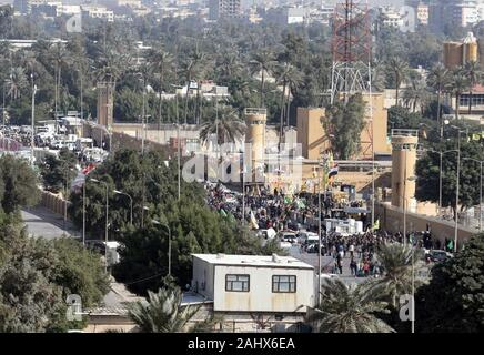 Baghdad, Iraq. 01st Jan, 2020. Assailants and attackers storm the entry control point at the U.S. Embassy in Baghdad, Iraq, on January 1, 2020. Dozens of angry Iraqi Shiite militia supporters broke into the U.S. Embassy compound in Baghdad on Tuesday, December 31, 2019, after smashing a main door and setting fire to a reception area. Photo by Maj. Charlie Dietz/U.S. Army/UPI Credit: UPI/Alamy Live News - Stock Photo