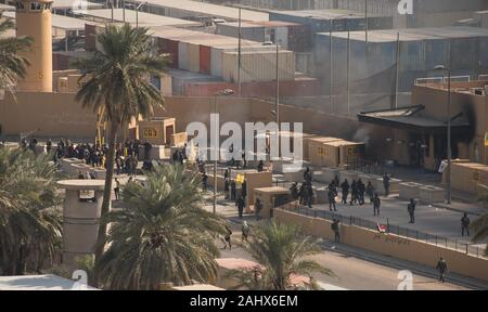 Baghdad, Iraq. 01st Jan, 2020. Crowds of assailants and attackers mingle with Iraqi Security Forces at the gates of the U.S. Embassy Compound in Baghdad, Iraq, on January 1, 2020. Dozens of angry Iraqi Shiite militia supporters broke into the U.S. Embassy compound in Baghdad on Tuesday, December 31, 2019, after smashing a main door and setting fire to a reception area. Photo by British Lt. Col. Adrian Weale/Department of Defense/UPI Credit: UPI/Alamy Live News - Stock Photo