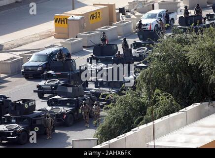 Baghdad, Iraq. 01st Jan, 2020. Iraqi Counter-Terrorism Service forces posture themselves near the U.S. Embassy in Baghdad, Iraq, on January 1, 2020. Dozens of angry Iraqi Shiite militia supporters broke into the U.S. Embassy compound in Baghdad on Tuesday, December 31, 2019, after smashing a main door and setting fire to a reception area. Photo by Maj. Charlie Dietz/U.S. Army/UPI Credit: UPI/Alamy Live News - Stock Photo