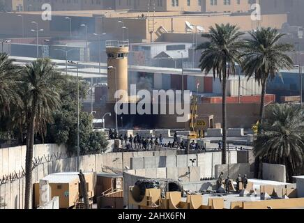 Baghdad, Iraq. 01st Jan, 2020. Assailants and attackers set fire to the perimeter wall of the U.S. Embassy in Baghdad, Iraq, on January 1, 2020. Dozens of angry Iraqi Shiite militia supporters broke into the U.S. Embassy compound in Baghdad on Tuesday, December 31, 2019, after smashing a main door and setting fire to a reception area. Photo by Maj. Charlie Dietz/U.S. Army/UPI Credit: UPI/Alamy Live News - Stock Photo