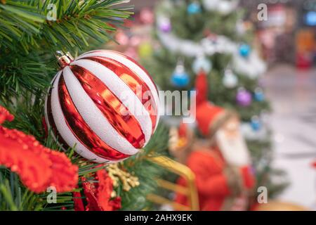 Decorated Christmas tree on blurred background - Stock Photo