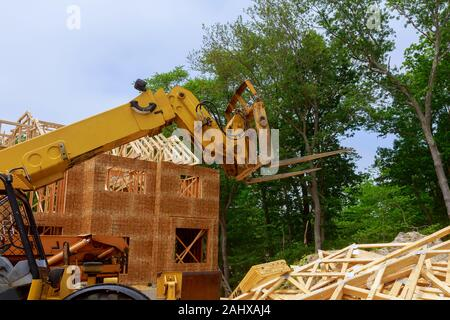 Boom truck forklift in the New framing construction home - Stock Photo