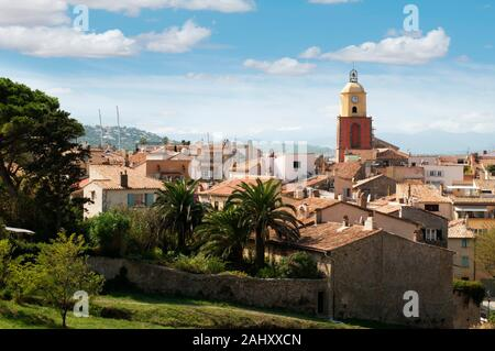 Clock Tower in St Tropez and ancient buildings in the resort. - Stock Photo
