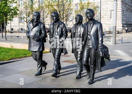 Bronze statue of pop group The Beatles (2015), sculpted by Andrew Edwards, Pier Head, Liverpool, England, UK. - Stock Photo