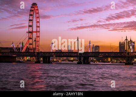 Landscape London skyline, London Eye, dusk, twilight, blue hour with the Southbank and River Thames travel destination, London England UK