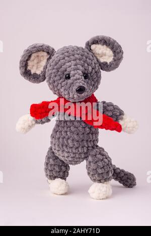 Funny knitted teddy mouse, white background. - Stock Photo