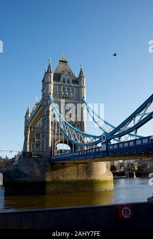 Tower Bridge on the banks of Thames river in London. - Stock Photo