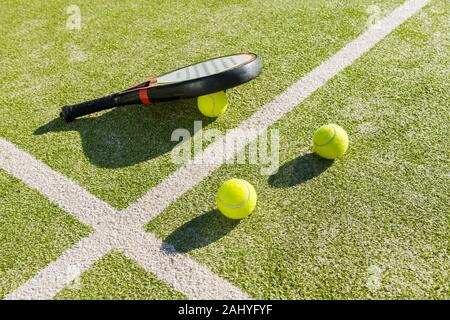 paddle tennis objects on court of artificial grass, indoor sports concept and sporty lifestyle - Stock Photo