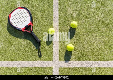 top view of paddle tennis objects on court of artificial turf, indoor sports concept and sporty lifestyle - Stock Photo
