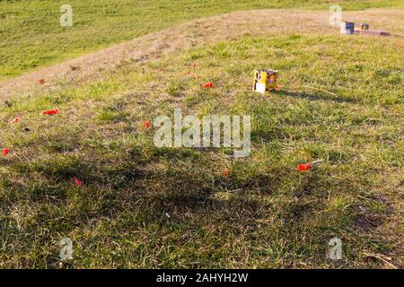 Fireworks waste litter, burnt grass after new years eve on grass - Stock Photo