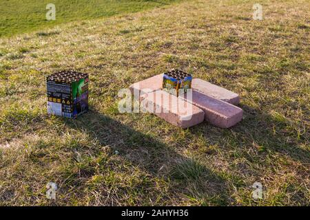 Fireworks waste litter after new years eve on grass - Stock Photo