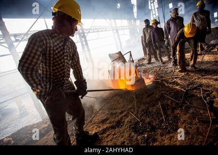 Blast furnace in the melt steel works, risky workers in steel factories are working at Demra, Dhaka, Bangladesh. - Stock Photo