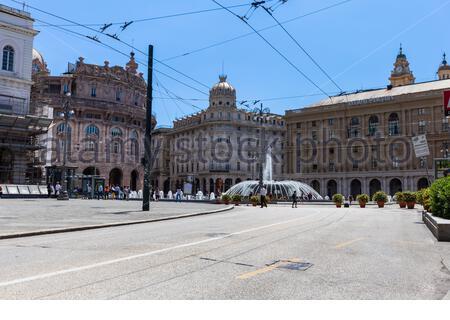 Piazza Raffaele De Ferrari square with fountain and Palazzo della Nuova Borsa Palace in historical centre of old city Genoa (Genova), Liguria, Italy - Stock Photo