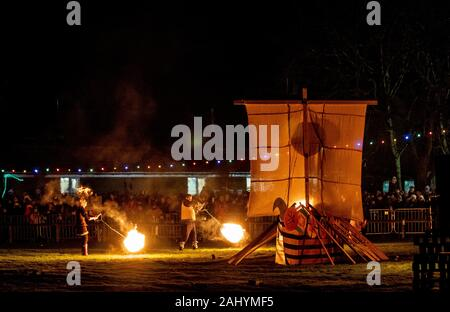 Flamborough Fire Festival. New Year's Eve 2019 celebrating the village connection with Viking History. Featuring the Flamborough Fireballs, Torchlit Procession and burning of a Viking Longboat on the village green. - Stock Photo