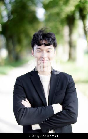 Korean man at countryside in Salzburg, Austria. - Stock Photo