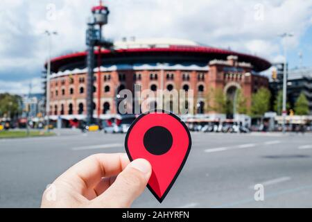 BARCELONA, SPAIN - APRIL 12, 2018: Closeup of the hand of a young caucasian man with a red marker at the Arenas de Barcelona, an old bullring that is - Stock Photo
