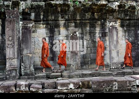 Buddhist monks in the inner part of Bayon temple,Angkor Thom, Cambodia,South Esat Asia. - Stock Photo