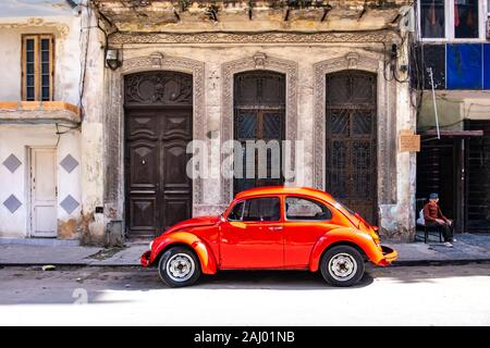 Volkswagen Beetle in the streets of Old Havana, Republic of Cuba, Caribbean, Central America. - Stock Photo