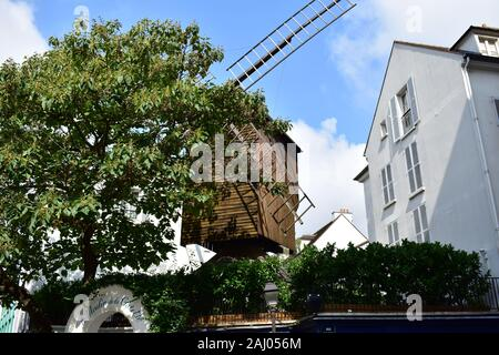 Moulin Radet also known as Moulin de la Galette from Rue Lepic at Montmartre neighbourhood. Paris, France. August 14, 2018. - Stock Photo