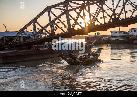 Boat with passengers leaving jetty pier in Yangon , Myanmar. - Stock Photo