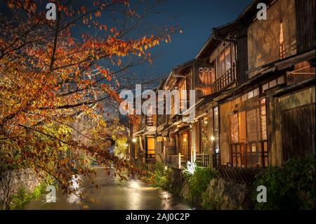 A stream runs past old wooden houses on Shirakawa Dori in the Gion district of Kyoto, Japan