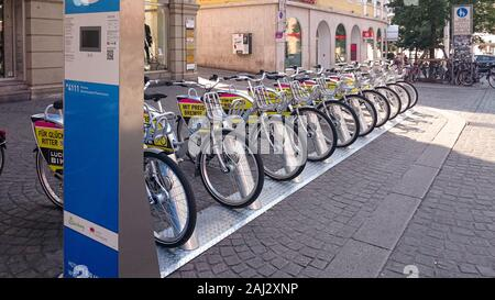 Wurzburg, Germany - August 9, 2015: Station of the bicycle rental company 'Nextbike' in the old town of Würzburg Germany - Stock Photo