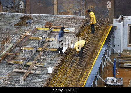 Construction site, reinforced concrete rebar, for a building ceiling, are being assembled, - Stock Photo