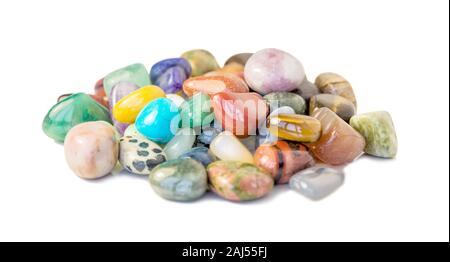 Lot of various multicolored gems isolated on white background - Stock Photo