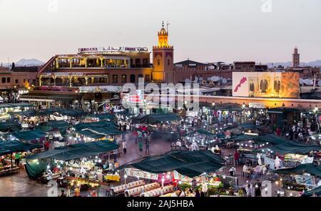 Night lights at UNESCO World Heritage Jamaa el Fna or Djemaa el-Fnaa  market square, Marrakesh, Morocco, north Africa. - Stock Photo
