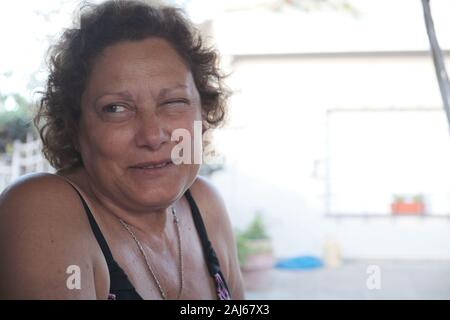 close up portrait of an adult woman making funny faces - Stock Photo
