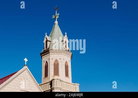 Hakodate Catholic Church bell tower against blue winter sky, famous attraction in Motomachi district - historic Roman Catholic church Gothic architect