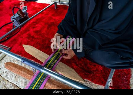 Arabian woman in traditional dress (Abaya) - Emirati dress - traditional and heritage celebrations | vintage and history - Stock Photo