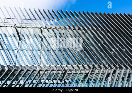 Angled parallel lines on the facade of a modern architecture building - Stock Photo