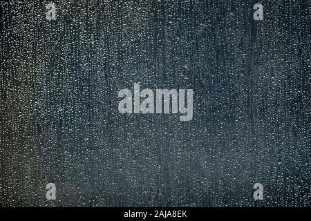 Genoa, Italy. 22 September, 2019: Raindrops on a glass are seen prior to the Serie A football match between UC Sampdoria and Torino FC. Credit: Nicolò Campo/Alamy Live News - Stock Photo