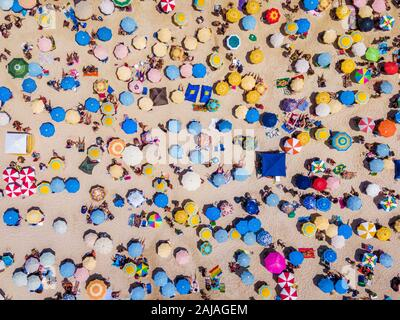 Rio de Janeiro, Brazil, top view of Copacabana Beach showing colourful umbrellas and people relaxing on a summer day.