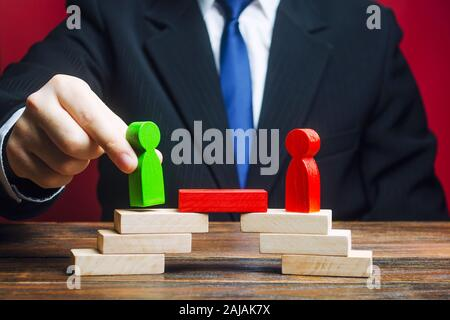 The man provides the conditions for negotiations and conflict resolution between opponents. Confrontation rivals. Build bridges, improve relationships - Stock Photo