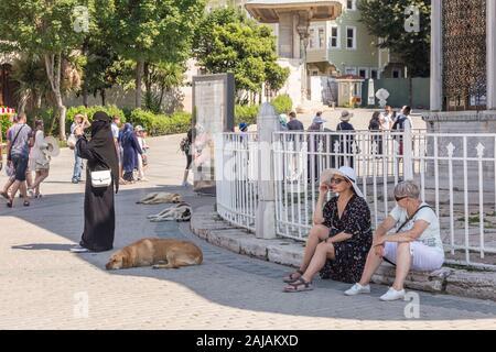 Istanbul, Turkey - July 15  2018: Woman rest in shade near Hagia Sophia at Istanbul Turkey. - Stock Photo