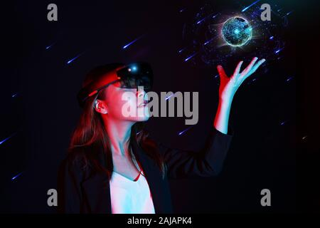 Empowered women in innovate modern technology - Young business girl trying mixed reality with hololens 1 - Virtual and Augmented reality concept - Stock Photo