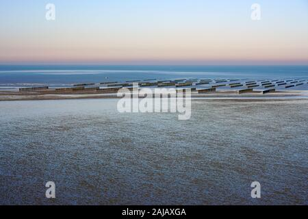 View of Bouchot mussels farming in the Atlantic Ocean in the Baie de Saint Brieuc at low tide from the Pointe des Guettes in Cotes d'Armor, Brittany, - Stock Photo