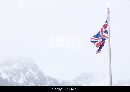 British flag at Port Lockroy (penguin post office), Antarctica - Stock Photo