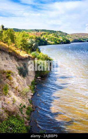 Beautiful landscape with sheer sand hill in sunny day with cloudy sky, Kaniv Reservoir, Ukraine