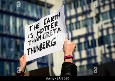 Turin, Italy - 29 November, 2019: A placard reading 'The earth is hotter than Greta Thunberg' is seen during 'Fridays for future' demonstration, a worldwide climate strike against governmental inaction towards climate breakdown and environmental pollution. Credit: Nicolò Campo/Alamy Live News - Stock Photo