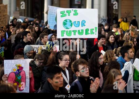 Turin, Italy - 29 November, 2019: Protester holds placard reading 'It's our future' during 'Fridays for future' demonstration, a worldwide climate strike against governmental inaction towards climate breakdown and environmental pollution. Credit: Nicolò Campo/Alamy Live News - Stock Photo