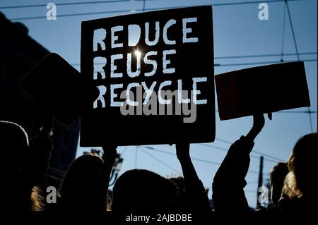 Turin, Italy - 29 November, 2019: Protesters hold placard reading 'Reduce refuse recycle' during 'Fridays for future' demonstration, a worldwide climate strike against governmental inaction towards climate breakdown and environmental pollution. Credit: Nicolò Campo/Alamy Live News - Stock Photo