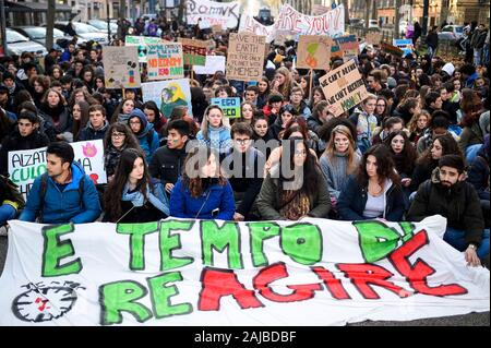 Turin, Italy - 29 November, 2019: Protesters sit-in during 'Fridays for future' demonstration, a worldwide climate strike against governmental inaction towards climate breakdown and environmental pollution. Credit: Nicolò Campo/Alamy Live News - Stock Photo