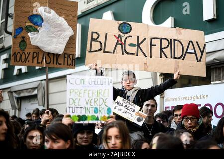 Turin, Italy - 29 November, 2019: Protester holds placard reading 'Black Friday' during 'Fridays for future' demonstration, a worldwide climate strike against governmental inaction towards climate breakdown and environmental pollution. Credit: Nicolò Campo/Alamy Live News - Stock Photo