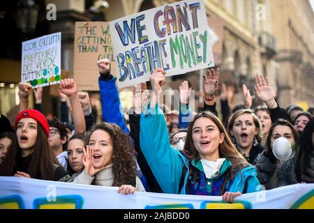 Turin, Italy - 29 November, 2019: Protester hold placard reading 'We can't breathe money' during 'Fridays for future' demonstration, a worldwide climate strike against governmental inaction towards climate breakdown and environmental pollution. Credit: Nicolò Campo/Alamy Live News - Stock Photo